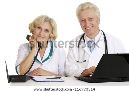 elderly doctors with a laptop on a white - stock photo