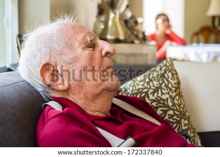 Elderly eighty plus year old man asleep in a home setting. - stock photo