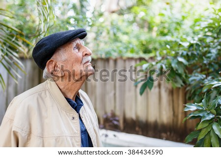 Elderly eighty plus year old man in a outdoor setting.