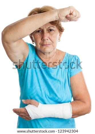 Elderly hispanic woman with a broken arm defending herself against an aggressor (isolated on white) - stock photo