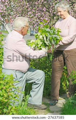 elderly husband give bouquet wife