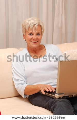 Elderly Lady with Laptop - stock photo