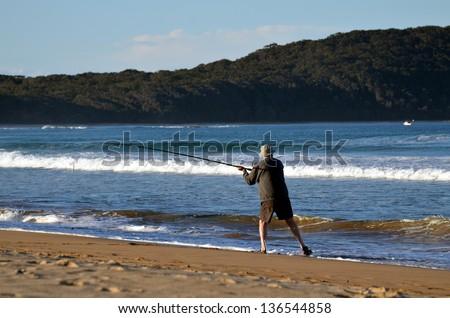 elderly male beach fishing - stock photo