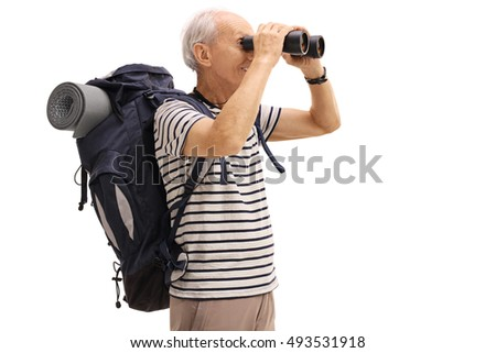 Elderly male hiker looking through binoculars isolated on white background