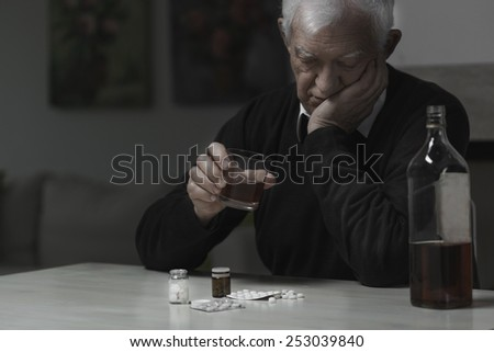 Elderly man addicted to alcohol and drugs - stock photo