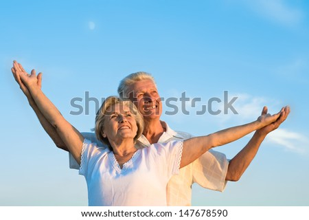 elderly man and an elderly woman resting together - stock photo