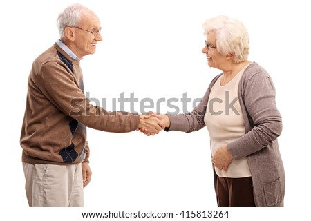 Elderly man and woman shaking hands and smiling isolated on white background - stock photo
