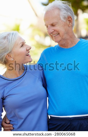 Elderly man and younger woman outdoors - stock photo