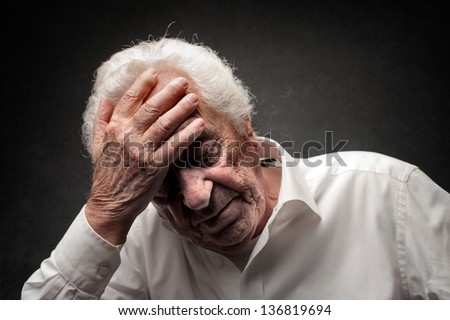 elderly man as a headache - stock photo