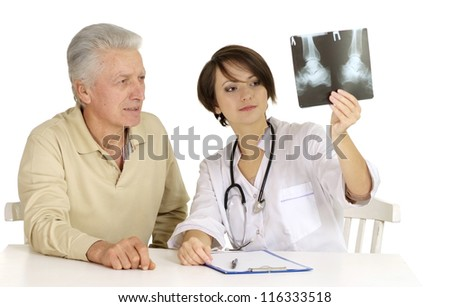 Elderly man came to the reception to the young doctor - stock photo