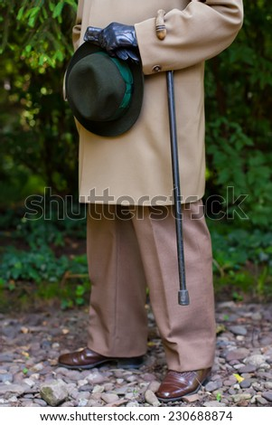 Elderly man getting ready for a walk. - stock photo