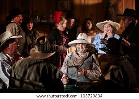 Elderly man holds up players in a poker game - stock photo