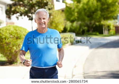 Elderly man jogging - stock photo