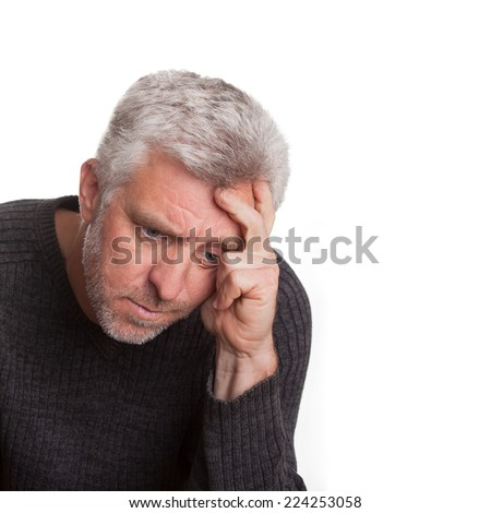 Elderly man lost in depression thought - stock photo