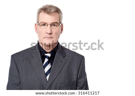 Elderly man posing in a serious expression
