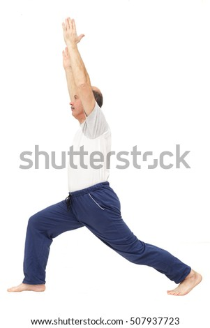 Elderly man practicing yoga or fitness. Positive mood on sports activities. standing asana of yoga