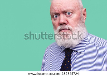 Elderly man, senior, is posing on blue background, color and contrast manipulated - stock photo
