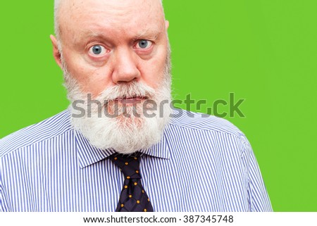 Elderly man, senior, is posing on green background, color and contrast manipulated - stock photo