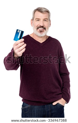 Elderly man showing credit card to camera - stock photo