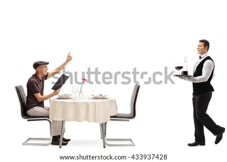 Elderly man sitting at a restaurant table and calling the waiter isolated on white background - stock photo
