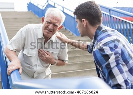 Elderly man suffering from strong pain in chest - stock photo