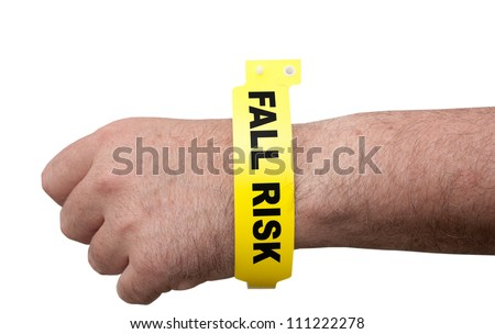 Elderly man wearing a hospital medical ID bracelet around his arm