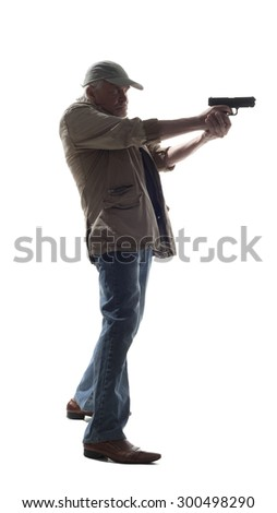 Elderly man with a gun in the shadow isolated on white background - stock photo