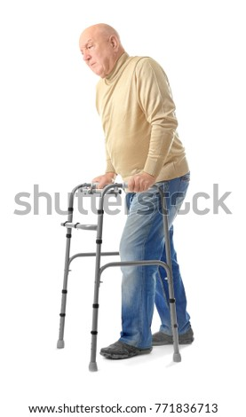 Elderly man with walking frame on white background
