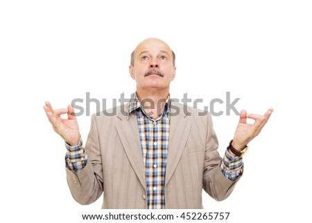 Elderly manager in a business suit meditating. Fingers in form of yoga hand position