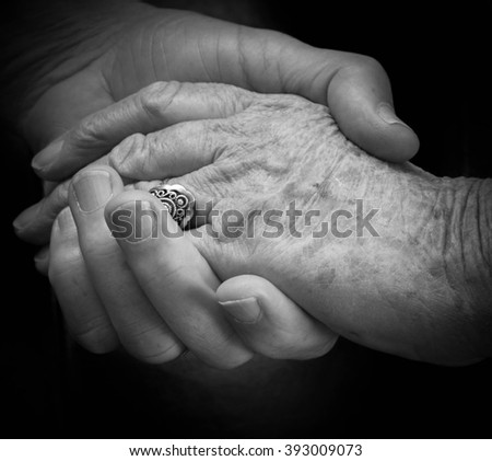 elderly  married couple holding hands, close up