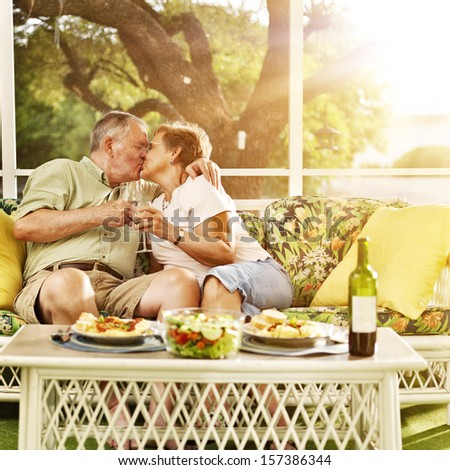 elderly married couple kissing - stock photo