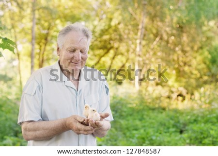 elderly men with chick