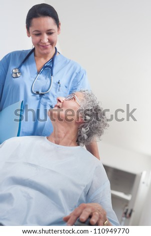 Elderly patient in a wheelchair in hospital ward - stock photo