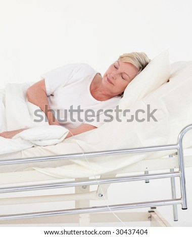 Elderly Patient lying in bed in a hospital - stock photo