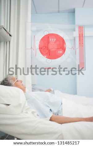 Elderly patient lying in hospital bed with futuristic ECG data display in a hospital ward