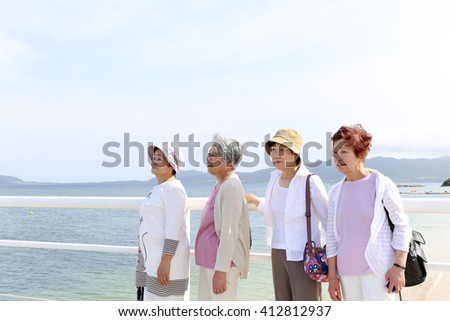 Elderly people are looking at the landscape