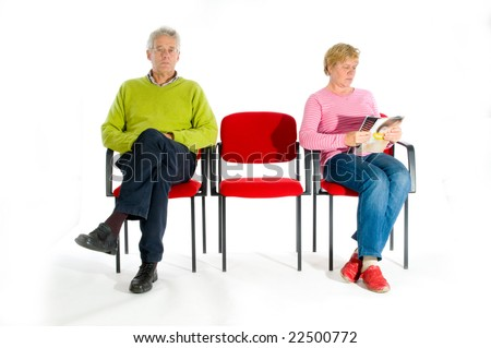 Elderly people in the waiting room by the doctor - stock photo