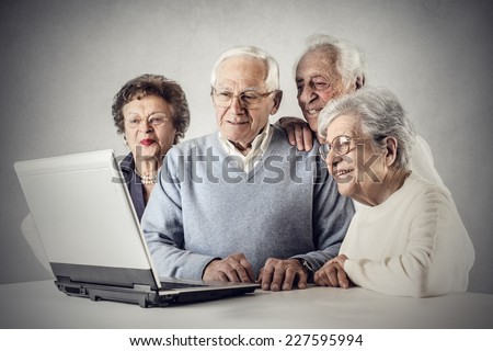 Elderly people using a pc  - stock photo