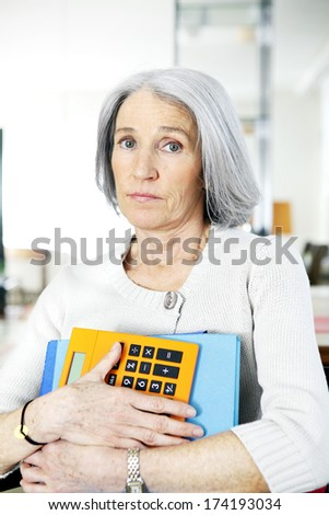 Elderly Person Doing Paperwork