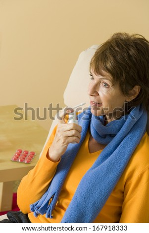 Elderly Person Using Mouth Spray