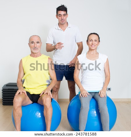 Elderly persons at physiotherapy