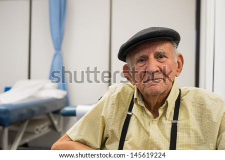 Elderly 80 plus year old man receiving physical therapy. - stock photo