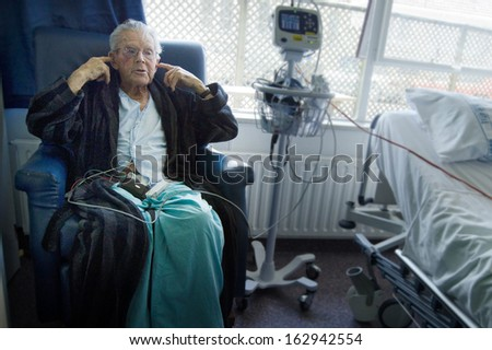 Elderly 90 plus year old man recovering from surgery in a hospital. - stock photo