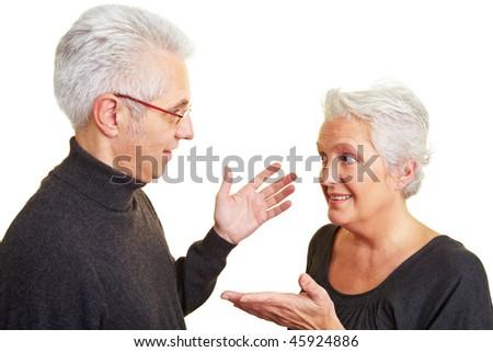 Elderly senior couple having an intense discussion - stock photo