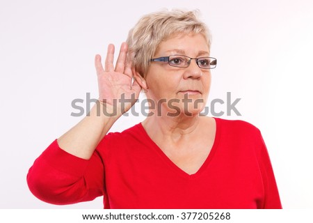Elderly senior woman placing hand on ear, difficulty in hearing in old age, showing human emotions, facial expressions - stock photo