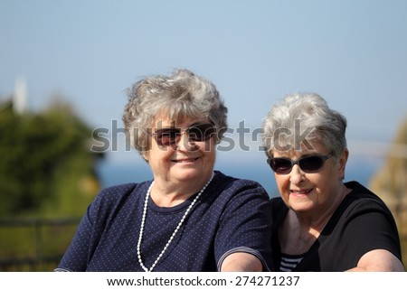Elderly twin sisters on holiday