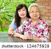 Elderly woman and her daughter - stock photo