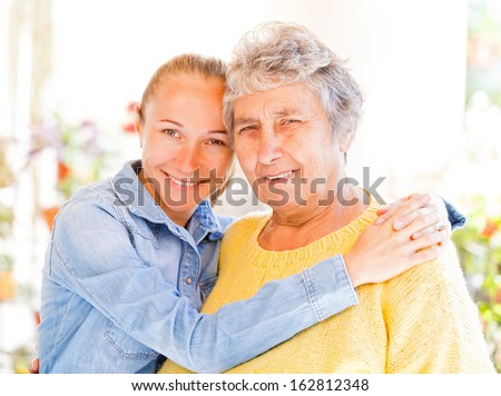 Elderly woman and her daughter enjoying themselves - stock photo