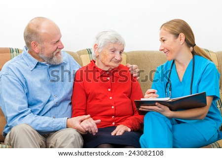 Elderly woman and her son at the doctor - stock photo