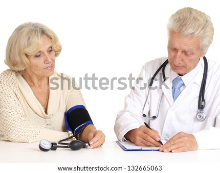 elderly woman came to the doctor over a white background